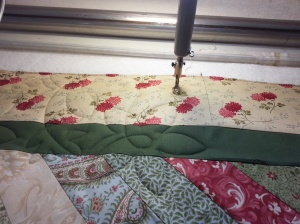 Quilt is on the Longarm Machine being quilted.
